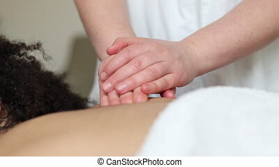 Back and scalp Massage - Young woman having a relaxing back...