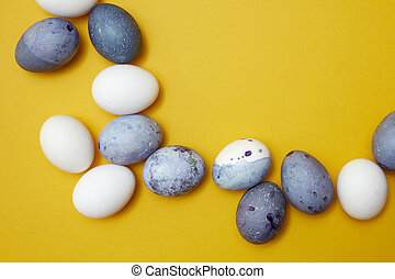 frame of colored eggs - Corner frame of colored eggs on a...