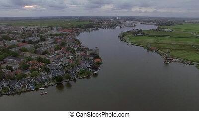 Aerial flight above the Koog Zaandijk, Netherlands. View of...