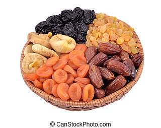 Various dried fruits in wicker bowl on a white background