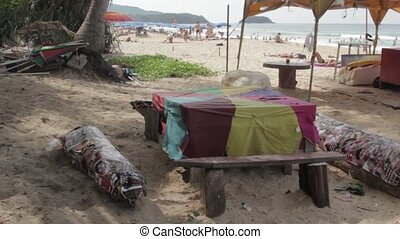 Holidays in Phuket - People sunbathing on the beach in Karon