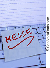 note on computer keyboard: fair - a memo is on the keyboard...