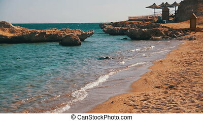 Egypt, Sandy Beach of the Red Sea and the Sea waves on the Shoreline in Slow Motion