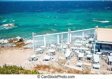 Summer empty openair cafe in popular area in Mykonos Little...