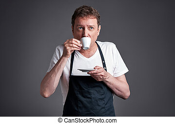 Man with a cup of coffee - A middle age man drink and taste...