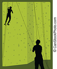 Rock Climbing - A pair of rock climbers scaling a wall in a...