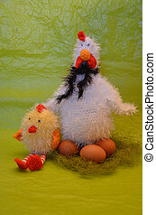 Easter scene with chicken with eggs and chick against yellow...
