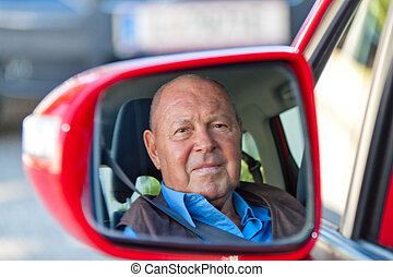 Senior as a car driver in the car Buckle up seat belt -...