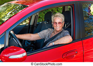 Senior as a car driver in the car. Belt buckle - Older Woman...