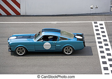 Classic Car Race - Image of a classic car racing at the...