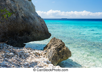 Rocks and clear water - swim paradise on tropical Curacao...