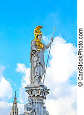 Pallas Athena statue in front of Austrian Parliament, Vienna, Austria against the blue cloudy sky background