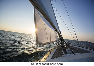Yacht Sailing In Sea During Sunset