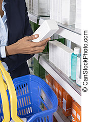 Businesswoman Holding Product In Pharmacy
