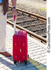 Suitcases for your luggage on the platform at a train...