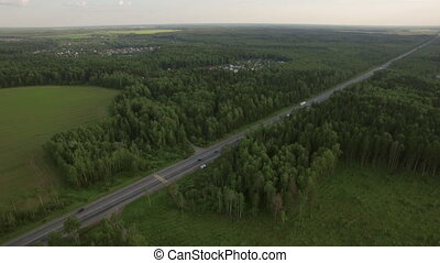 Aerial shot of road traffic in the countryside, Russia -...