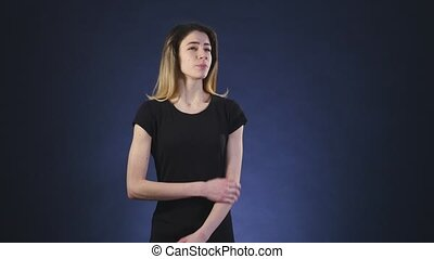 worried woman on a dark background