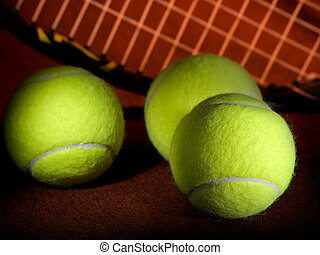 Tennis balls and racket - tennis balls with the racket in...
