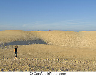 Woman having a walk in the dunes
