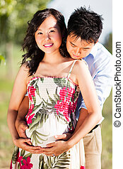 Pregnant couple - A portrait of a pregnant wife with her...