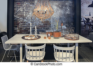 dinner table in front of  brick wall