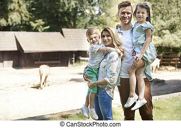 Portrait of happy family at the zoo