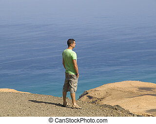 Young man looking at nature - Young man looking at the...
