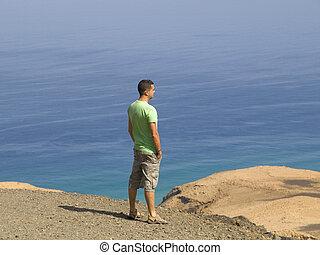 Young man looking at nature