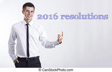 2016 resolutions 1. 2. 3. - Young smiling businessman...