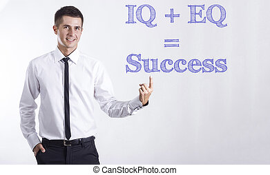 IQ + EQ = Success - Young smiling businessman pointing on...