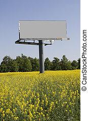 Billboard in field - Big billboard in field with colza