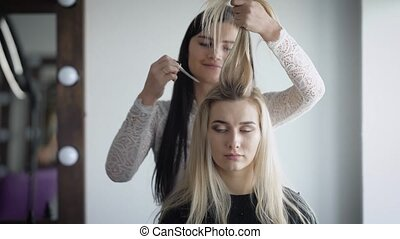 Professional stylists working on a new and fashionable shape...