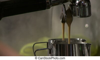 Making coffee in electric coffe machine in a cafe - Barista...
