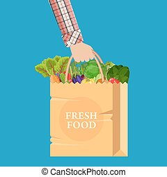 Paper shopping bag full of different healthy food. in hand....