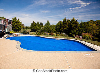 Blue solar pool cover - Bubble wrap like pool cover pulled...