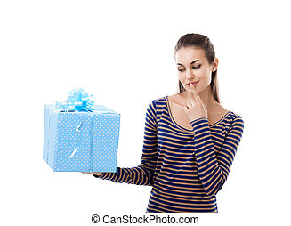 Young beautiful woman thinking about gift box holding it on...