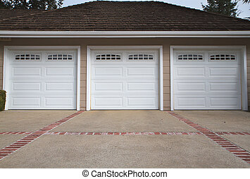 Three car garage close - Beige three ar garage with white...