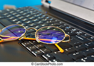 Golden glasses on laptop
