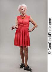 Happy senior lady with beaming smile - Pretty in red dress....