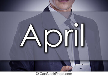 April - Young businessman with text - business concept