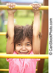 Sweet little girl at the playground