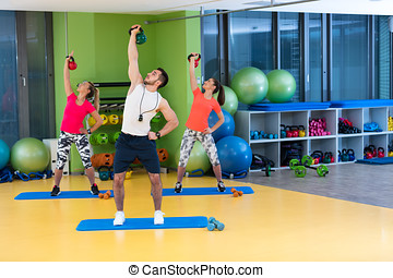 Kettlebells swing exercise man and woman workout at gym.