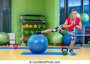Beautiful woman training pilates in gym