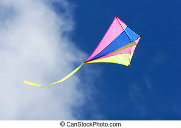 flying kite - a kite flying against a blue sky in sunlight,...