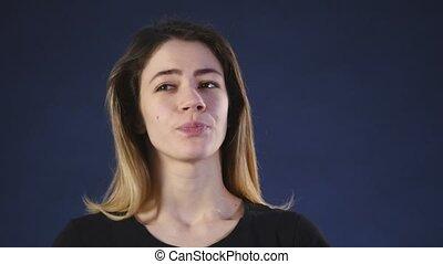 worried woman on a dark background.