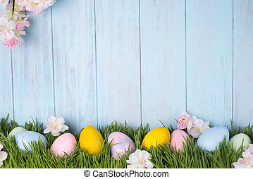 decorated easter eggs in the grass - Easter concept with...