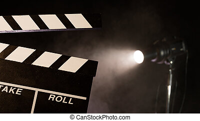 Filmmakers clapperboard, studio light on background -...