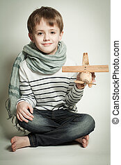 Smiling child boy with toys