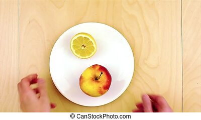Putting healthy nutritious ingredients, apple, cheese,...