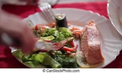 Salmon steak with vegetables on a plate